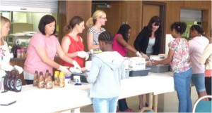 Members of the Young Professsional Board host an ice cream social