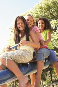 3 Girls on See-Saw Stock Photo